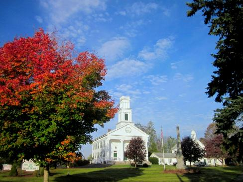 A sugar maple frames the historic Congregational Churchon the Plymouth Green.