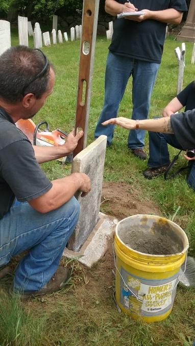 gravestone repair with level